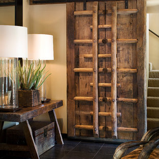 Inspiration for a southwestern foyer remodel in Phoenix with white walls