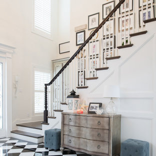 Transitional multicolored floor and wall paneling foyer photo in Kansas City with white walls and a dark wood front door