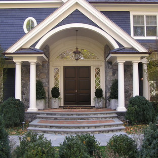 Ornate entryway photo in New York with a dark wood front door