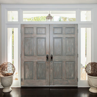 Example of a huge transitional dark wood floor entryway design in Philadelphia with beige walls