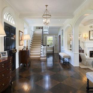 Entryway - large traditional dark wood floor and brown floor entryway idea in Philadelphia with a black front door