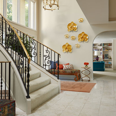 Large eclectic marble floor foyer photo in Minneapolis with beige walls