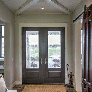 Transitional porcelain tile and gray floor entryway photo in Omaha with a glass front door and gray walls