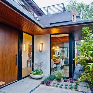 Contemporary front door in Los Angeles with a single front door and a medium wood front door.