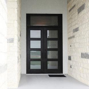 Entryway - contemporary entryway idea in Austin with a metal front door