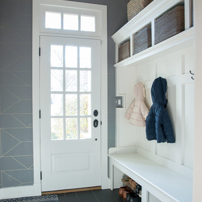 Transitional black floor entryway photo in Philadelphia with gray walls and a white front door