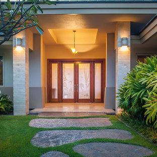 Mid-sized island style entryway photo in Hawaii with a glass front door