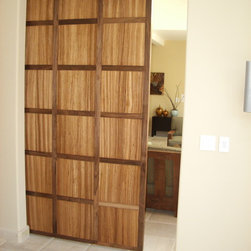 Walnut and Zebra Wood Hanging Door - Made in Los Angeles. Wanut frame with zebra wood insets. Clear finish. Can be custom ordered.