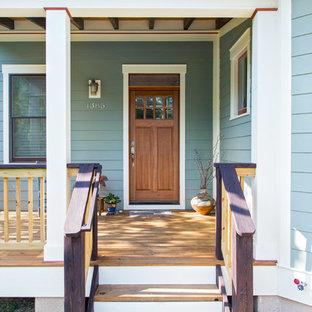 Entryway - craftsman entryway idea in Other with a medium wood front door