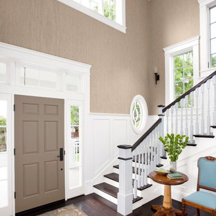 Inspiration for a large transitional dark wood floor entryway remodel in Charlotte with gray walls and a gray front door