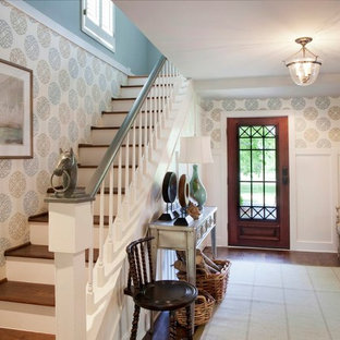 Design ideas for a mid-sized traditional foyer in Nashville with a single front door, a glass front door, blue walls and medium hardwood floors.