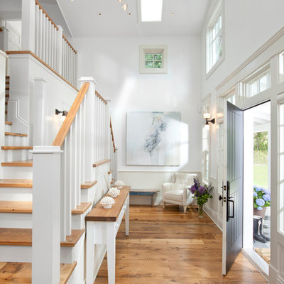 Inspiration for a timeless entryway remodel in Vancouver with a black front door