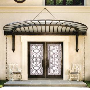 Entryway - mediterranean entryway idea in New York with a dark wood front door