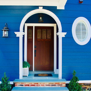 Inspiration for a timeless blue floor entryway remodel in Philadelphia with blue walls and a medium wood front door