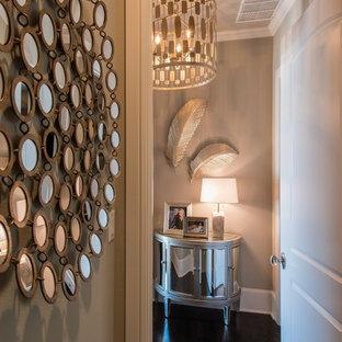 Mid-sized trendy dark wood floor entryway photo in Dallas with gray walls