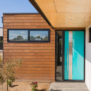 This is an example of a contemporary front door in Melbourne with a single front door and a blue front door.