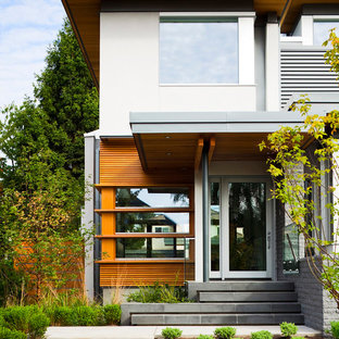 Mid-sized trendy entryway photo in Vancouver with a glass front door