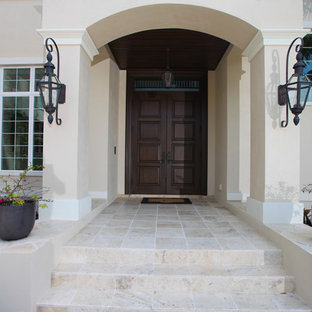 Mid-sized transitional entryway photo in Tampa with beige walls and a dark wood front door
