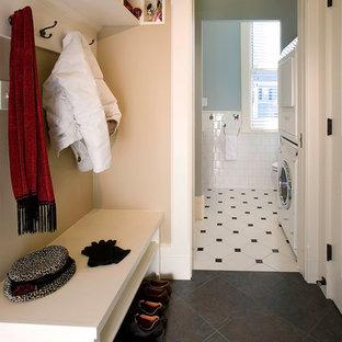 Small elegant slate floor and black floor mudroom photo in Boston with beige walls