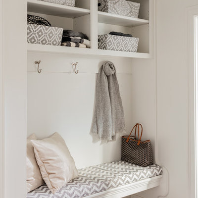 Example of a small classic mudroom design in Boston with white walls
