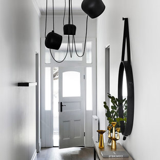 Inspiration for a contemporary dark wood floor entryway remodel in Houston with white walls and a white front door