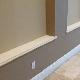Mid-sized transitional travertine floor entryway photo in Tampa with beige walls and a white front door