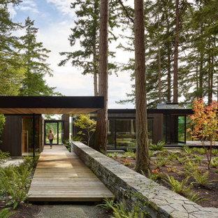 Idées déco pour une entrée moderne avec une porte simple et une porte en verre.
