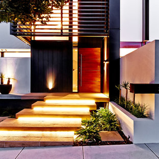 Large trendy entryway photo in Melbourne with a medium wood front door