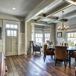 Inspiration for a large contemporary medium tone wood floor and brown floor entryway remodel in Atlanta with gray walls and a gray front door