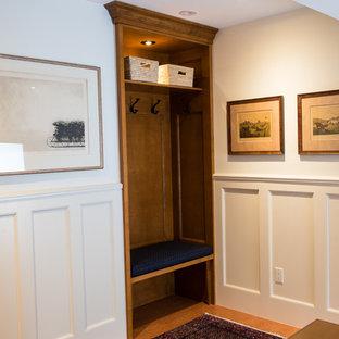 Idéer för att renovera en mellanstor vintage ingång och ytterdörr, med vita väggar, korkgolv, en enkeldörr och en vit dörr