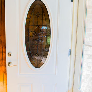Inspiration for a mid-sized timeless cork floor and brown floor single front door remodel in New Orleans with brown walls and a white front door