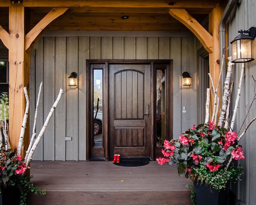 mid sized mountain style entryway photo in orange county with a dark wood front door - County For Rustic Home Designs