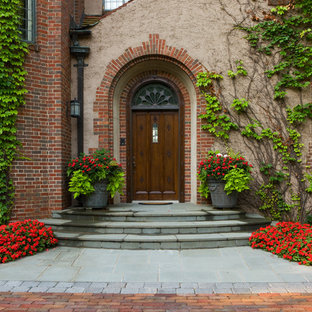 Example of a classic entryway design in Minneapolis with a dark wood front door