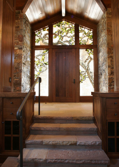 Rustic Entry by Mahoney Architects & Interiors