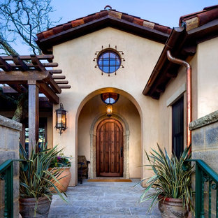 Tuscan entryway photo in San Francisco with a dark wood front door
