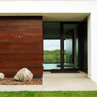 Entryway - modern entryway idea in Minneapolis with a glass front door
