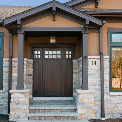 Inspiration for a craftsman single front door remodel in Chicago with a dark wood front door