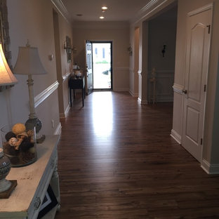Wood look laminate replaces builder-grade cherry for a pet-friendly home