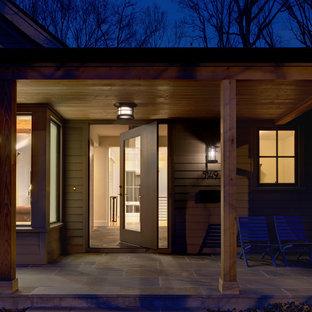 Ispirazione per una porta d'ingresso design con una porta a pivot