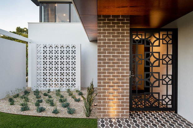 Contemporary Entry by Revell Landscaping