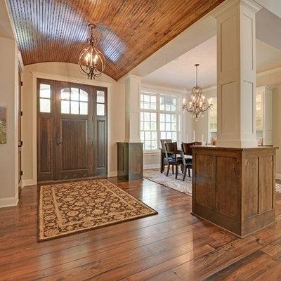 Entryway - traditional medium tone wood floor entryway idea in Minneapolis with beige walls and a medium wood front door