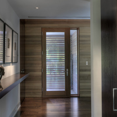 Inspiration for a contemporary entryway remodel in Baltimore with a glass front door