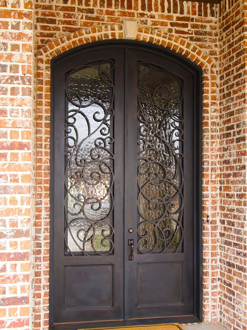metal front doorFront Door with a Metal Front Door and Brown Walls Ideas  Design