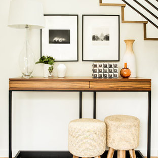 This is an example of a contemporary entryway in San Francisco with white walls and medium hardwood floors.