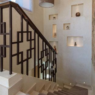 Foto de escalera en L, de estilo zen, grande, con escalones de mármol, contrahuellas enmoquetadas y barandilla de metal