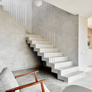 Example Of A Mid Sized Trendy Concrete L Shaped Staircase Design In Other