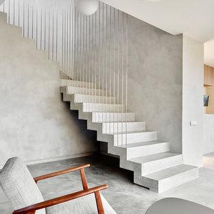 Идея дизайна: угловая лестница среднего размера в современном стиле с бетонными ступенями и бетонными подступенками