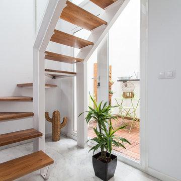 Rehabilitación apartamento doble altura con patio