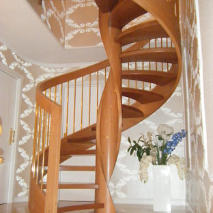 Example of a small transitional wooden spiral open staircase design in Madrid