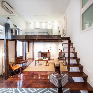 Inspiration for a contemporary wooden open and glass railing staircase remodel in Madrid
